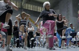 Women take part in an aerobics class at the gymnasium of a sports center in Cartago, east of San Jose July 10, 2012. REUTERS/Juan Carlos Ulate